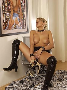 Nasty blonde in black boots showing off massive juggies