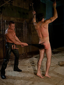 Muscular leatherman ties up and fucks a hot sailor.
