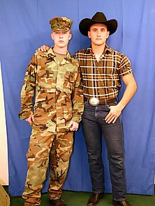 A cowboy and a soldier posing naked in front of mirrors