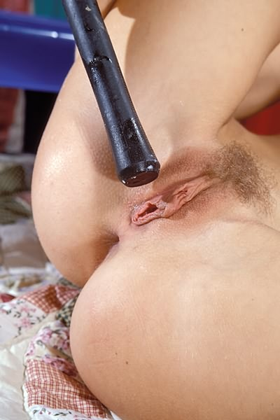 Pinching her clit hard