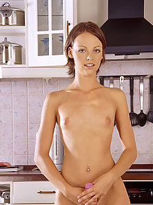 Tiny titted brunnete coed dildofucks her moist pussy in the kitchen.