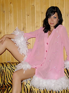 Hot alluring teenie in feathered blouse posing with her legs wide open