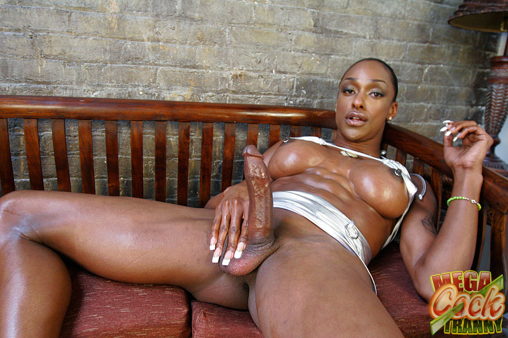 Tranny taking black cock, deep in black pussy