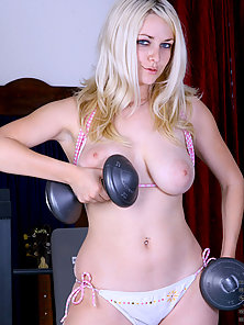 Jess pretty tough lifting a dumbbell and display her huge yummy boobie