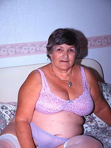 Horny fat granny spreads her nasty big folds